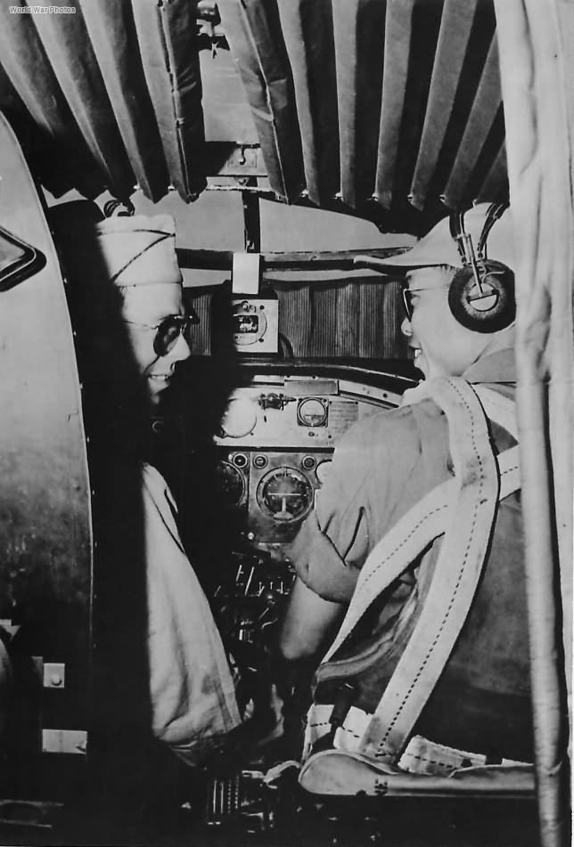 US pilot and Chinese Co-Pilot in cockpit of B-25 '44