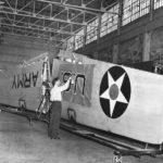 Workman stenciling insignia