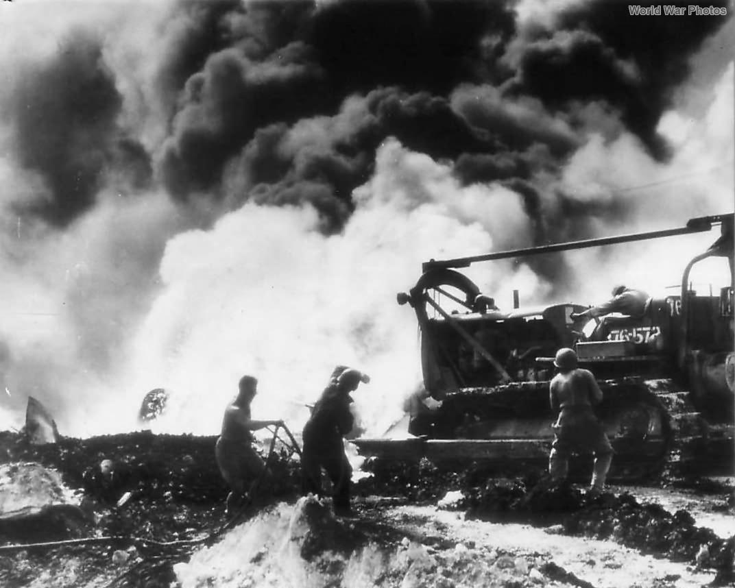 Aviation Engineers man bulldozer by bAviation Engineers man bulldozer by burning B-29 on Saipan December 1944urning B-29 on Saipan dec44