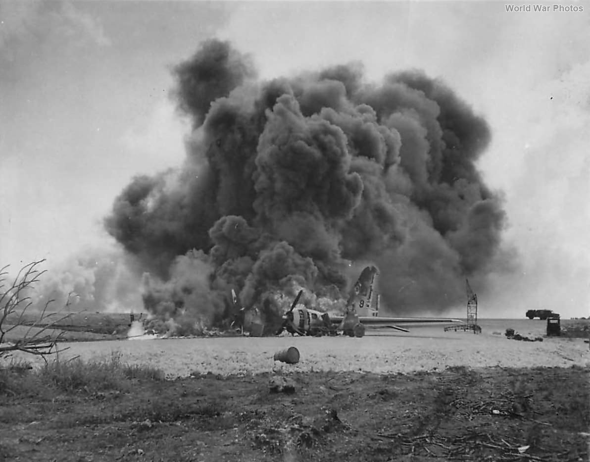 Burning B-29 of 73rd BW following Japanese attack on Isley Field 1944