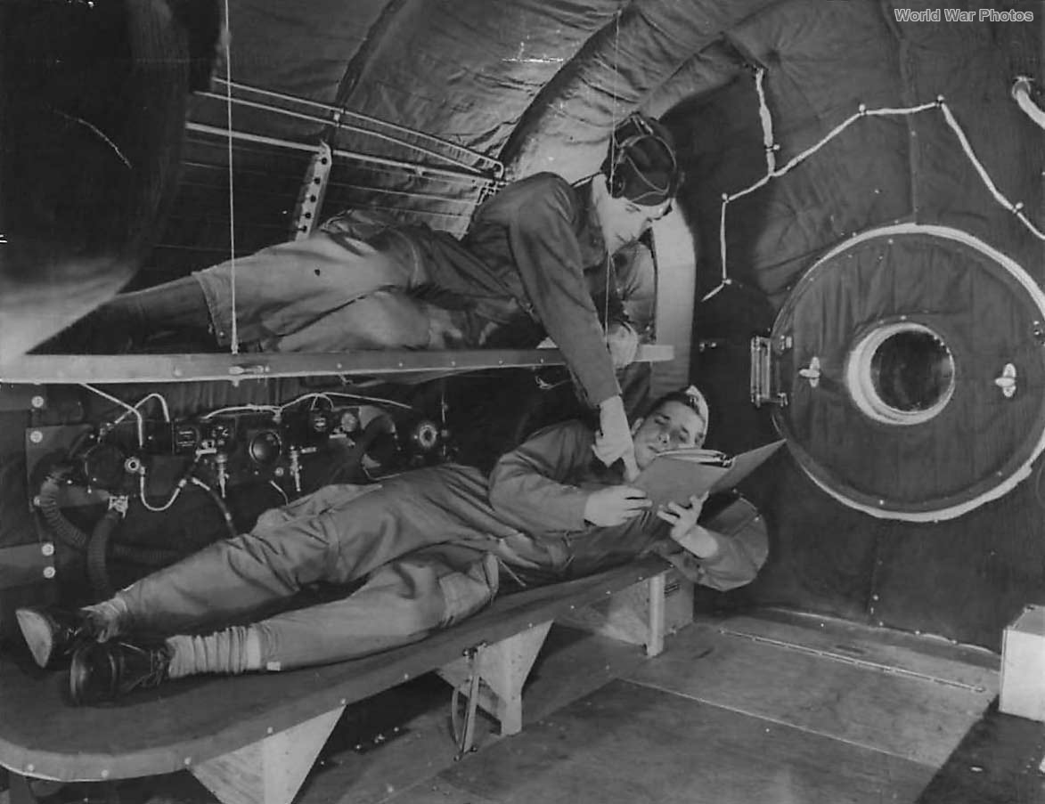 Crewmembers relax on bunks in crew compartment of B-29