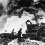 Aviation Engineers man bulldozer by bAviation Engineers man bulldozer by burning B-29 on Saipan December 1944urning B-29 on Saipan dec44