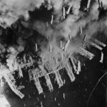 Bombs falling from B-29s on Port of Kobe '45
