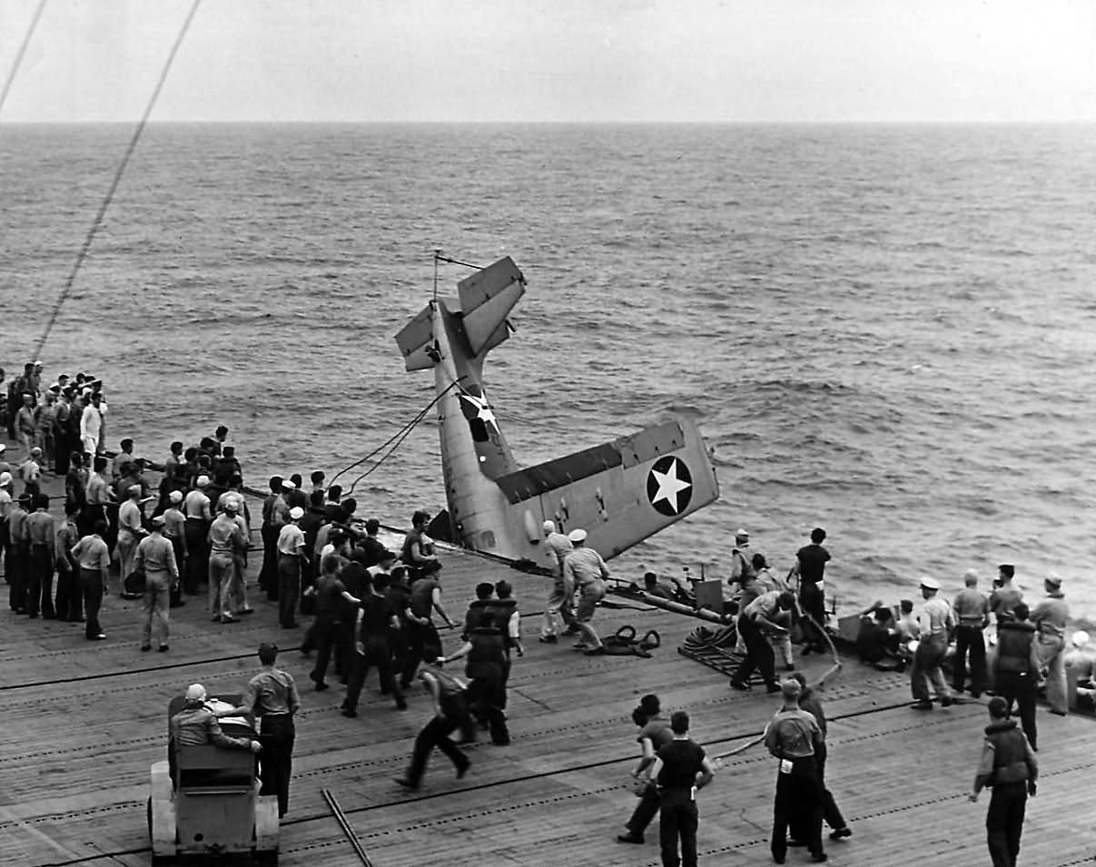 Aircraft Carrier Crash Crew Rescues F4F Wildcat after bad landing ...