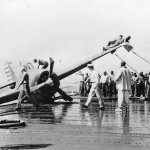 Crew aboard Aircraft Carrier Work to Right Crashed Wildcat 1942