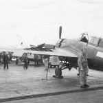 Pilot by His damaged F4F Wildcat on Aircraft Carrier Deck