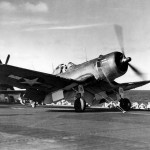 F4U-1A Corsair 16 of VMF-422 hooked up to a catapult and ready for launch from the escort carrier USS Kalinin Bay CVE-68 Tarawa – January 24, 1944