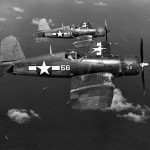 "F4U-1A Corsairs #56 ""Sun Set"", #51 of VMF-113 in flight over Eniwetok Atoll on July 9, 1944"
