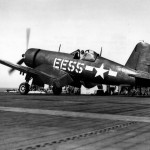 F4U-1D Corsair code EE55 of VMF-512 on a catapult ready to launch from the USS Gilbert Islands CVE-107 – March 6, 1945