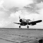 "F4U-1 Corsair code 17-F-10 of VF-17 ""Jolly Rogers"" catches a wire on board the aircraft carrier USS Bunker Hill CV-17 – July 11, 1943"