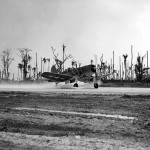 F4U-1 Corsair VMF-124 taxis on the airstrip at Munda Point August 26, 1943