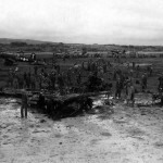 F4U Corsair 119 and wrecked US planes after Jap air attack on Yontan Airfield Okinawa 24 May 1945.