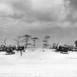 F4U Corsairs #105 #106 on airstrip