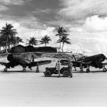 F4U Corsairs 804 707 of VMF-122 ready for take off on an airfield in the Palau Islands 1945