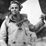 Marine fighter pilot Lt. David Riley by his F4U Corsair 22 1944