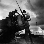 Marine mechanics work on an F4U's Pratt Whitney R-2800 – August 1943.