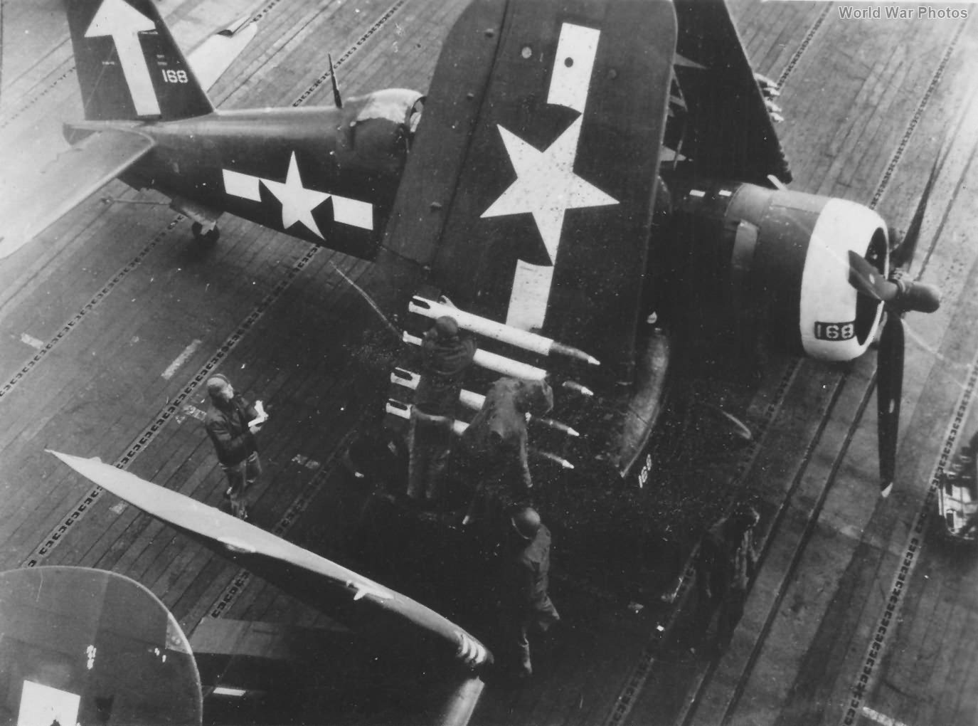 F4U-1D 168 of VF-84 being armed with rockets