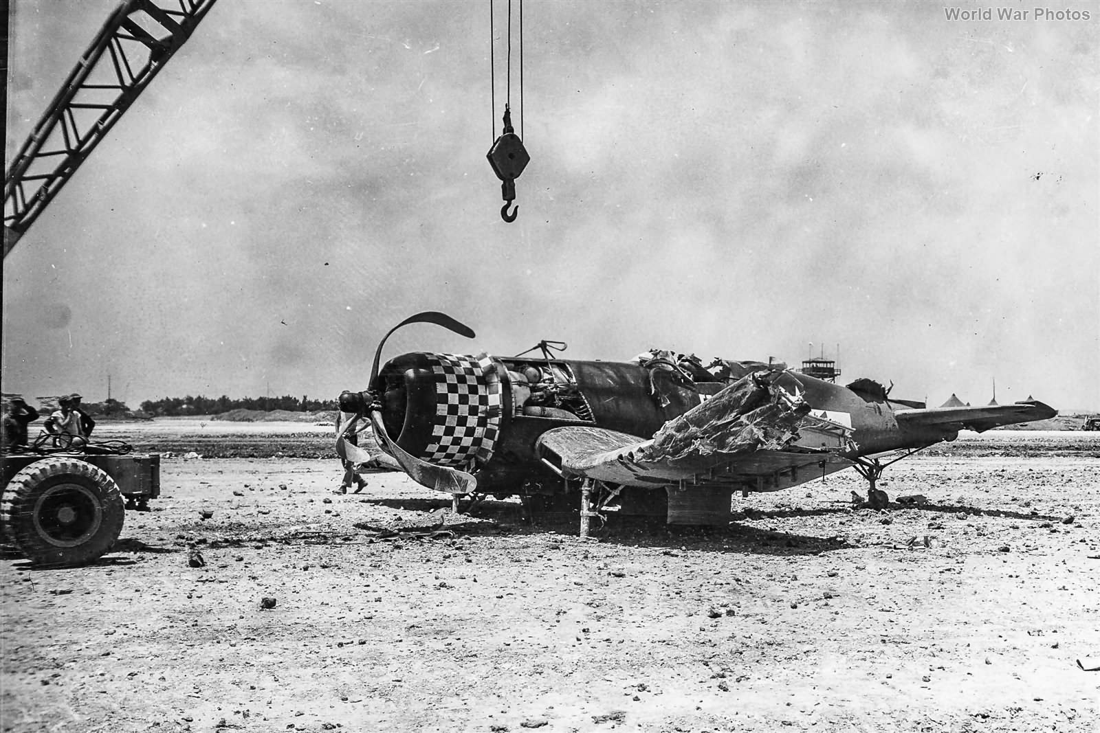 Marine F4U of the VMF-312 wreck at Kadena May 1945