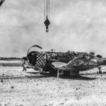 Marine F4U of the VMF-312 wreck at Kadena May 1945