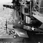 F6F-3 Hellcat #27 of VF-1 launches from the hangar deck catapult on board the carrier USS Yorktown (CV-10) June 3, 1943