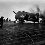 F6F-5N Hellcat #24 of VF(N)-90 burns on the flight deck of the carrier USS Enterprise CV-6 – April 1945 Okinawa