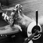 F6F-5P Hellcat #135 of VF-84 on the flight deck of the aircraft carrier Bunker Hill (CV-17) February 19, 1945 Iwo Jima