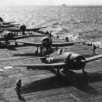 F6F-5 Hellcats of VF-80 prepare to launch from the aircraft carrier Ticonderoga CV-14 November 6, 1944. Hellcat #48 in foreground