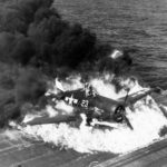 Pilot escaping from burning F6F-5 Hellcat code white 23 of VF-9 USS Lexington. Pilot Ens. Ardon R. Ives, 25 February 1945