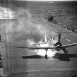 F6F Hellcat burning on deck of carrier USS Cowpens