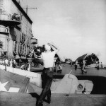 F6F Hellcat of VF-12 descends to the hangar deck on an aircraft elevator on board the carrier Saratoga CV-3 January 18, 1944