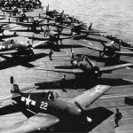 F6F Hellcats of VF 17 and VBF 17 on the flight deck of the aircraft carrier USS Hornet CV 12 March 16 1945