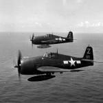 F6F Hellcats #68, #69 of VF-85 USS Shangri-La CV-38 in flight near Japan on August 17, 1945