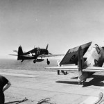 US F6F Hellcat fighter flying off the deck of HMS Empero and Grumman Hellcat of 800 Squadron