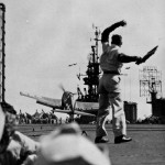 LSO on board the carrier Cowpens CVL 25 watches an F6F Hellcat of VF 25 November 20 1943