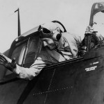 Lt Cdr Edward Outlaw waves from the cockpit of his F6F-3 Hellcat