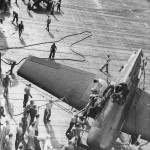 Pilot Helped from Crashed Hellcat 1944