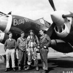 "1Lt Russell Bebout of the 79th FS 20th Fighter Group with his ground crew P-38J ""Betsy VI"" code MC-Y"