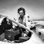 A Member Of the 94th Fighter Squadron 1st Fighter Group Checks Radio Equipment In A P-38 Lightning Italy