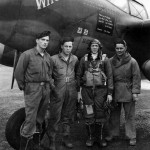 Capt Merle Nichols of the 79th FS 20th Fighter Group with his ground crew and P-38J 42-67515 coded MC-N