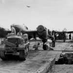Clertrac Aircraft Tug Tows P-38 Lightning at Manila Docks 1945