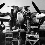 Ground crew members working on a P-38 Lightning England