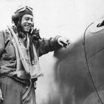 Lt Paul Fisher of the 38th Fighter Squadron 55th Fighter Group checks battle damage to his P-38 1944