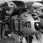 "P-38 Lightning ""640"" Armorers loading ammunition"