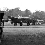 P-38 Lightnings of the 9th Fighter Squadron flight line at Dobodura May 1943