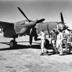USAAF fighter pilots inspect a newly arrived P-38F Lightning #13, 39th FS 5th AF Australia 1942