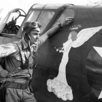 49th FG pilot Lt. John Angel by P-40 Nose Art 1942 Australia