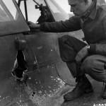 79th Fighter Group Based At Capodichino Italy pilot Examines his Damaged P-40