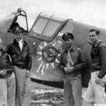 Former Members Of The AVG Serving With The 23rd Fighter Group Stand Beside A Curtiss P-40 With The Insignia Of The Group