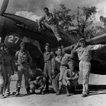 Members of the 49th Fighter Group pose beside a Curtiss P-40 at an air base in Buna New Guinea