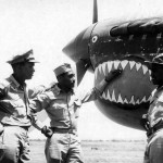 P-40 of the 332nd FG 99th Fighter Squadron. Pilots: 1st Lt Bolling Capt Lawrence jr and Capt Roberts Italy